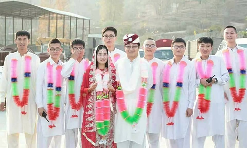 Chinese workers attend the ceremony dressed in traditional Pakistani attire. — Photo provided by the author