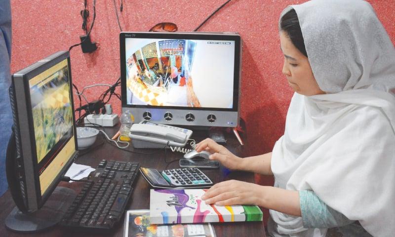 HAMIDA Ali calculating the bill of a patron at Hazara Restaurant in Quetta.  —Photo by Mazhar Ali Chandio