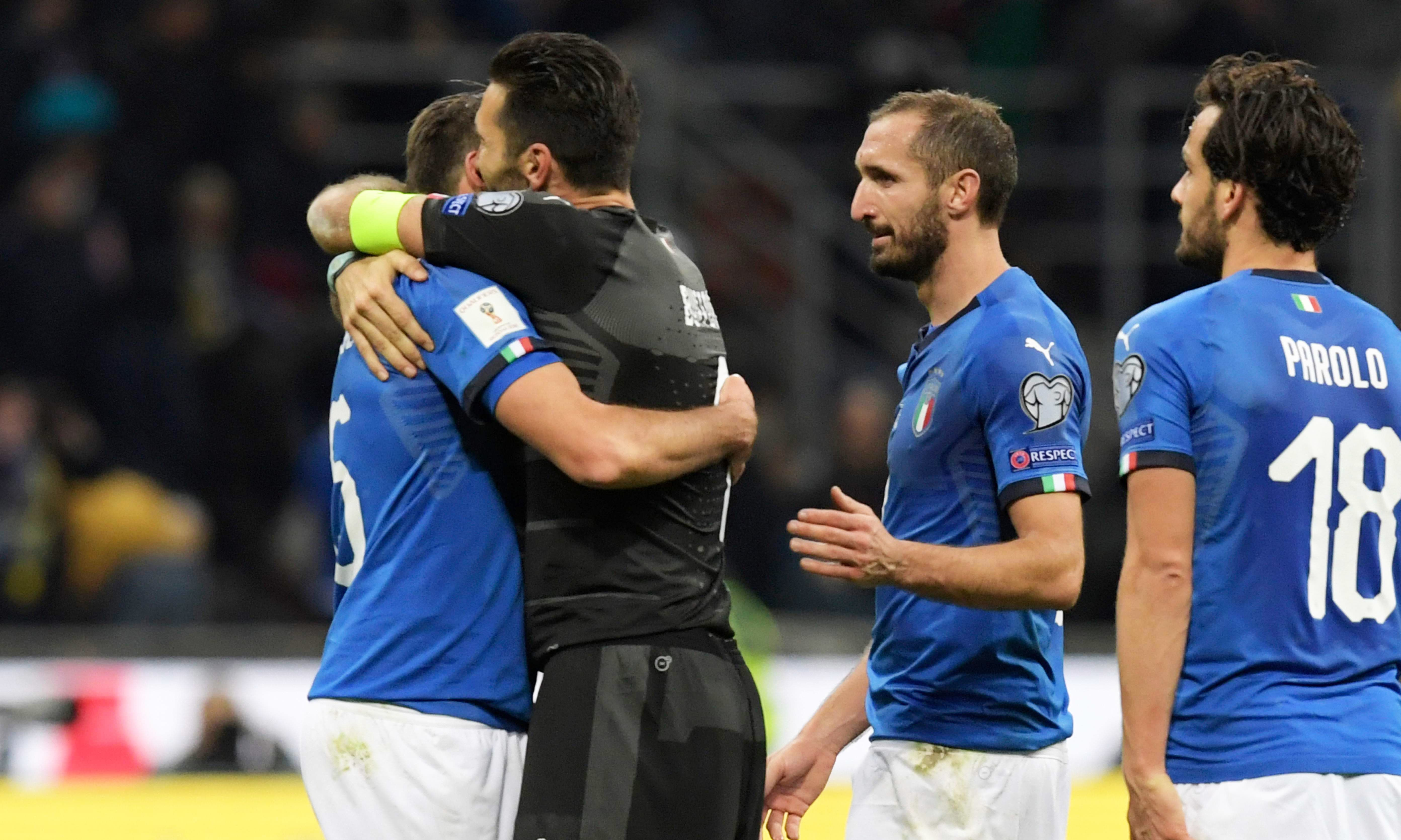From left: Italy's defender Andrea Barzagli, Italy's goalkeeper Gianluigi Buffon, Italy's midfielder Giorgio Chiellini and Italy's midfielder Marco Parolo react at the end of the FIFA World Cup 2018 qualification football match. —AFP