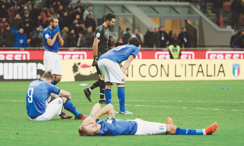 ITALIAN players are distraught following their failure to reach the World Cup.—Reuters