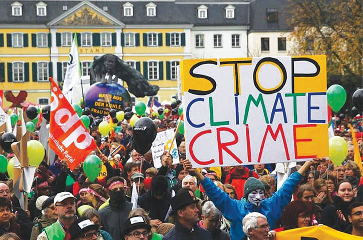 "People march during a demonstration under the banner ""Protect the climate — stop coal"" two days before the start of the COP23.—Reuters"