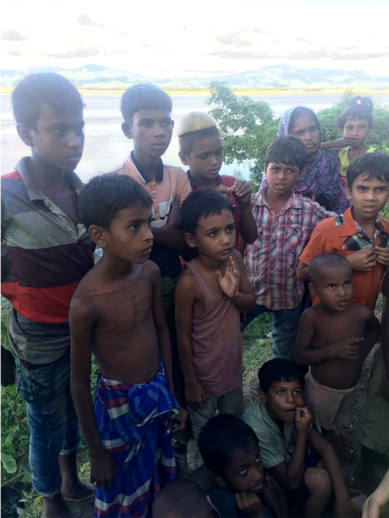 These children just crossed the Naf River to Bangladesh a few hours prior to this picture being taken. Myanmar can be seen in the background.