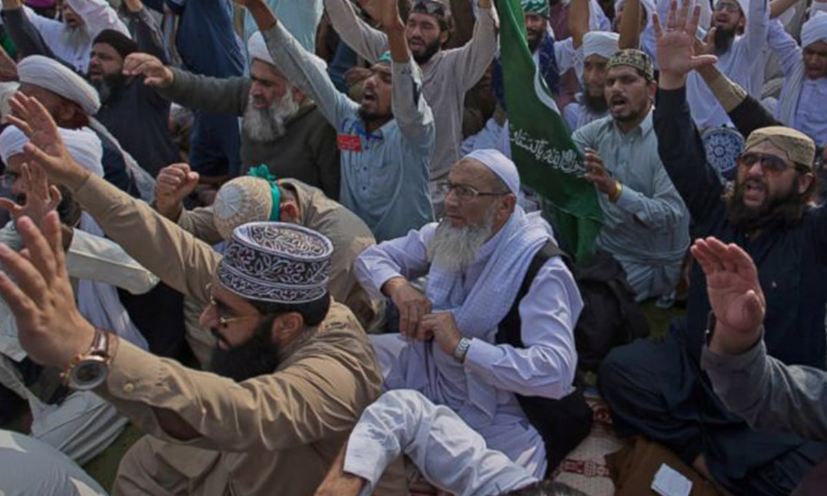Supporters of Tehreek e Pakistan shout slogans during a sit-in protest in Islamabad | AP