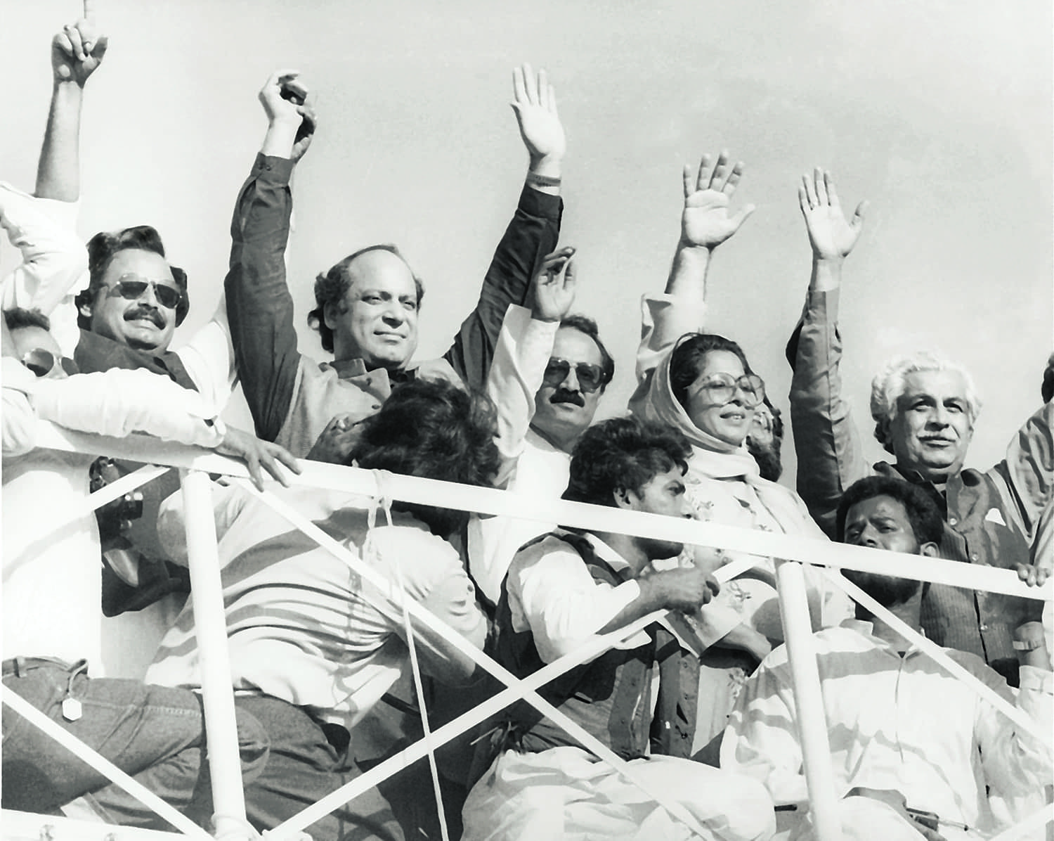 Contrary to what the photograph might depict, Nawaz Sharif has hardly ever been a silent, contemplative spectator on the national political scene. SHORTLY before being elected prime minister in November 1990, Nawaz entered into coalition, among others, with the Mohajir Qaumi Movement in urban Sindh. He is seen here at a rally in Karachi with MQM leader Altaf Hussain (left). Ghulam Mustafa Jatoi, who was heading the Combined Opposition Party (COP) in the National Assembly and was soon to become the caretaker prime minister, is on the extreme right next to Syeda Abida Hussain. | Photo: Hasan Bozai.