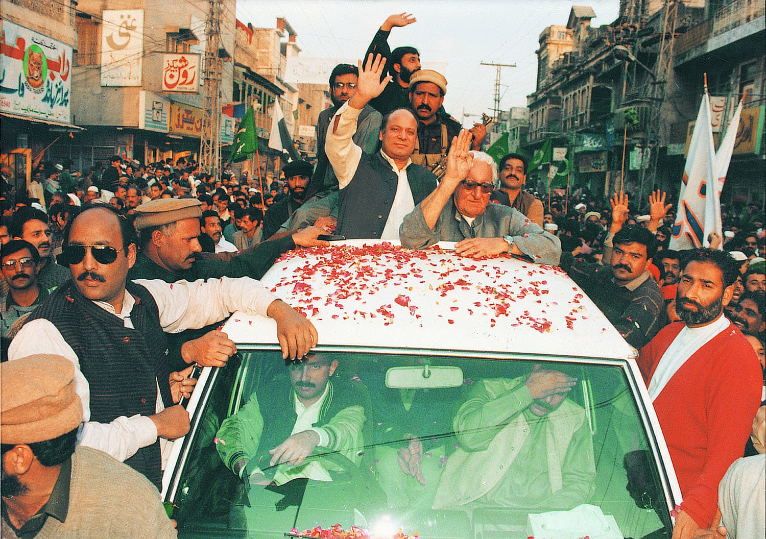 Between his first and second tenures at the helm during the politically troubled 1990s, Nawaz Sharif kept himself busy with public appearances across the land. He is seen here alongside Khan Abdul Wali Khan of the Awami National Party at a Rawalpindi rally in December 1994.