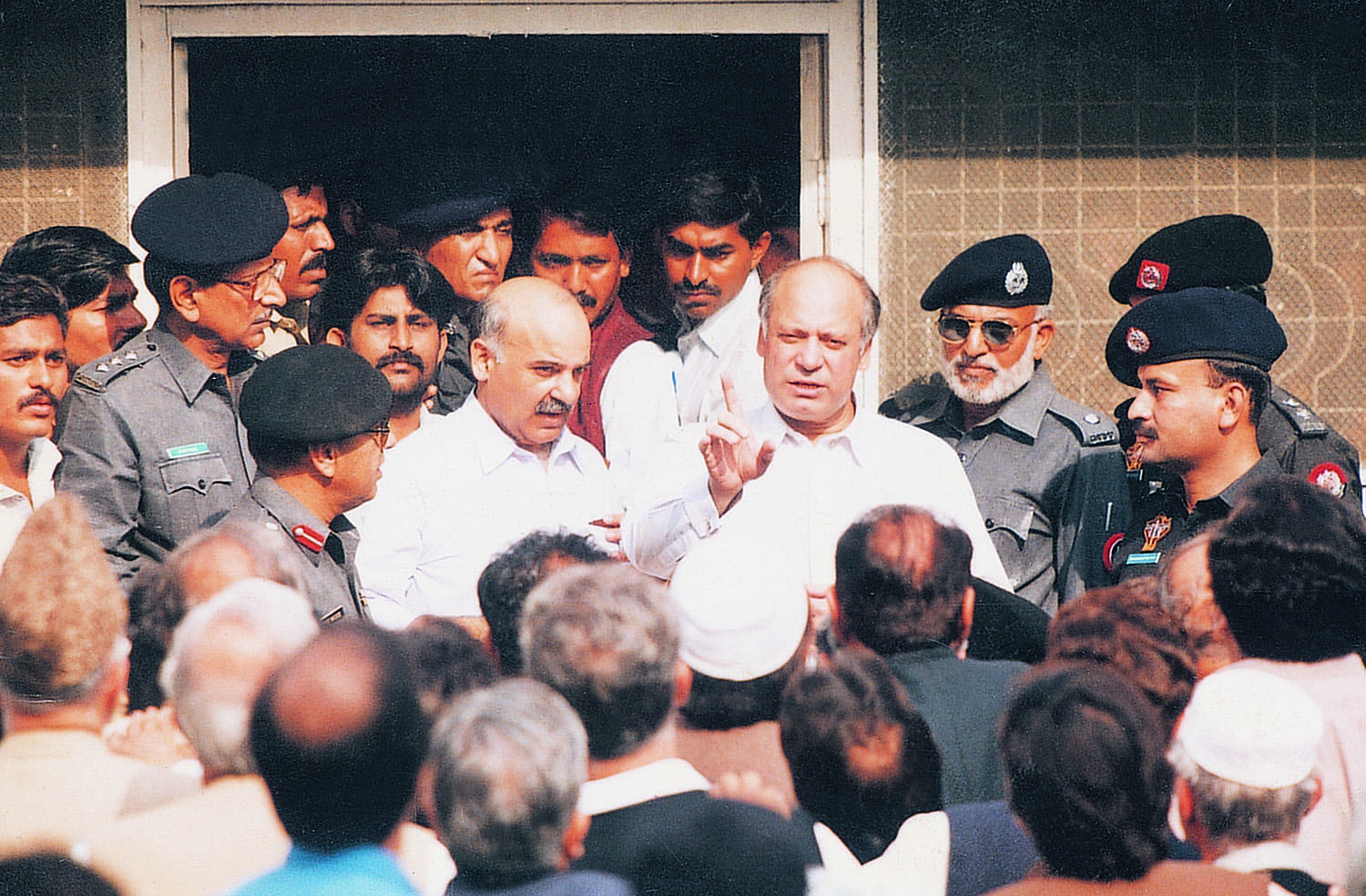 Deposed for the second time, Nawaz Sharif, with his brother Shahbaz Sharif, is seen at the entrance of Anti-terrorism Court No 1 in Karachi in December 1999 when he was tried for 'kidnapping, attempted murder, hijacking and terrorism'. It was the trial that led first to his conviction and a life sentence, and subsequently to the infamous agreement under which the Sharif family remained exiled in Saudi Arabia for about a decade.