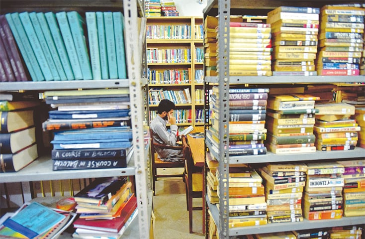 THE reading room at the Sayad Hashmi Reference Library in Malir. Students and young writers frequent the library during the week to read books on history and politics and look at archives.—Fahim Siddiqi / White Star