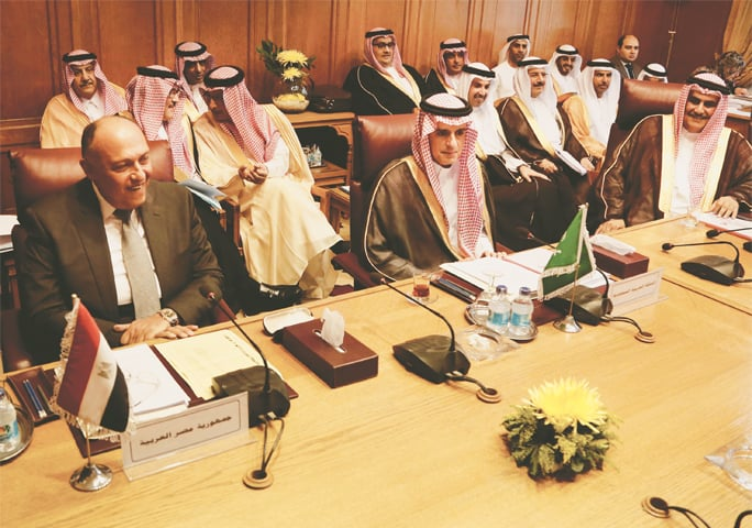 Cairo: Saudi Arabia's Foreign Minister Adel al-Jubeir (centre) and Egyptian Foreign Minister Sameh Shoukry (left) meet at the Arab League headquarters on Sunday.—AP