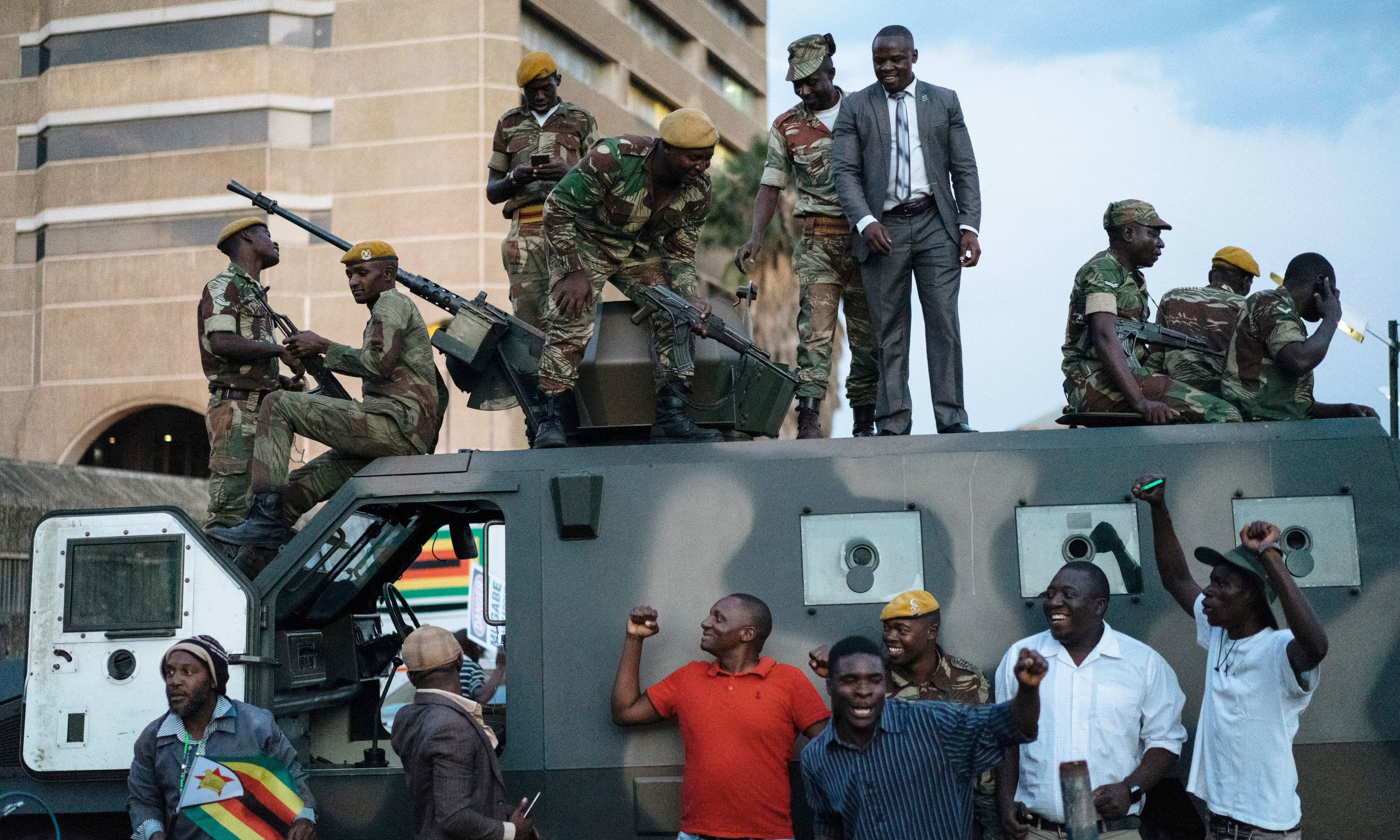 Zimbabwean soldiers are congratulated by citizens in the streets in Harare, on November 21, 2017 after the resignation of Zimbabwe's president Robert Mugabe. —AFP