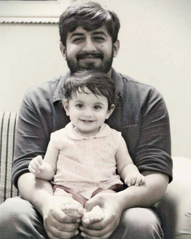 A photo of Major Ishaq with his one-year-old son.— ISPR