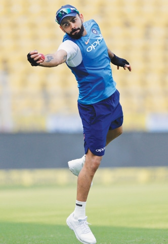 INDIAN captain Virat Kohli takes a catch during a practice session on Thursday, ahead of the second Test against Sri Lanka.—AP