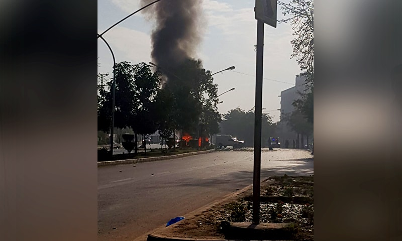 A suspected suicide attacker rammed his bike into a police vehicle and detonated his explosives, leaving the vehicle in flames. — DawnNews