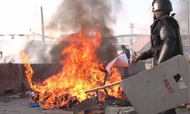 Protesters belongings are set on fire by security forces.— DawnNews