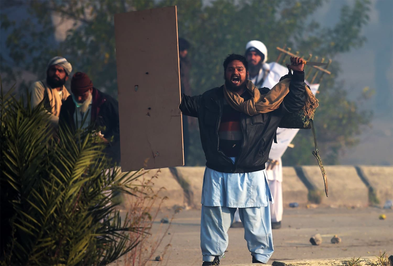 A TLY protester shouts slogans during a clash. ─ AFP
