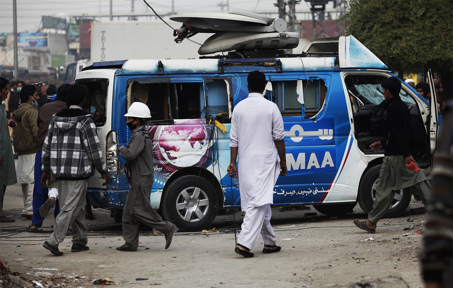 Protesters damage a Samaa DSNG during a clash with police in Islamabad. ─ AP