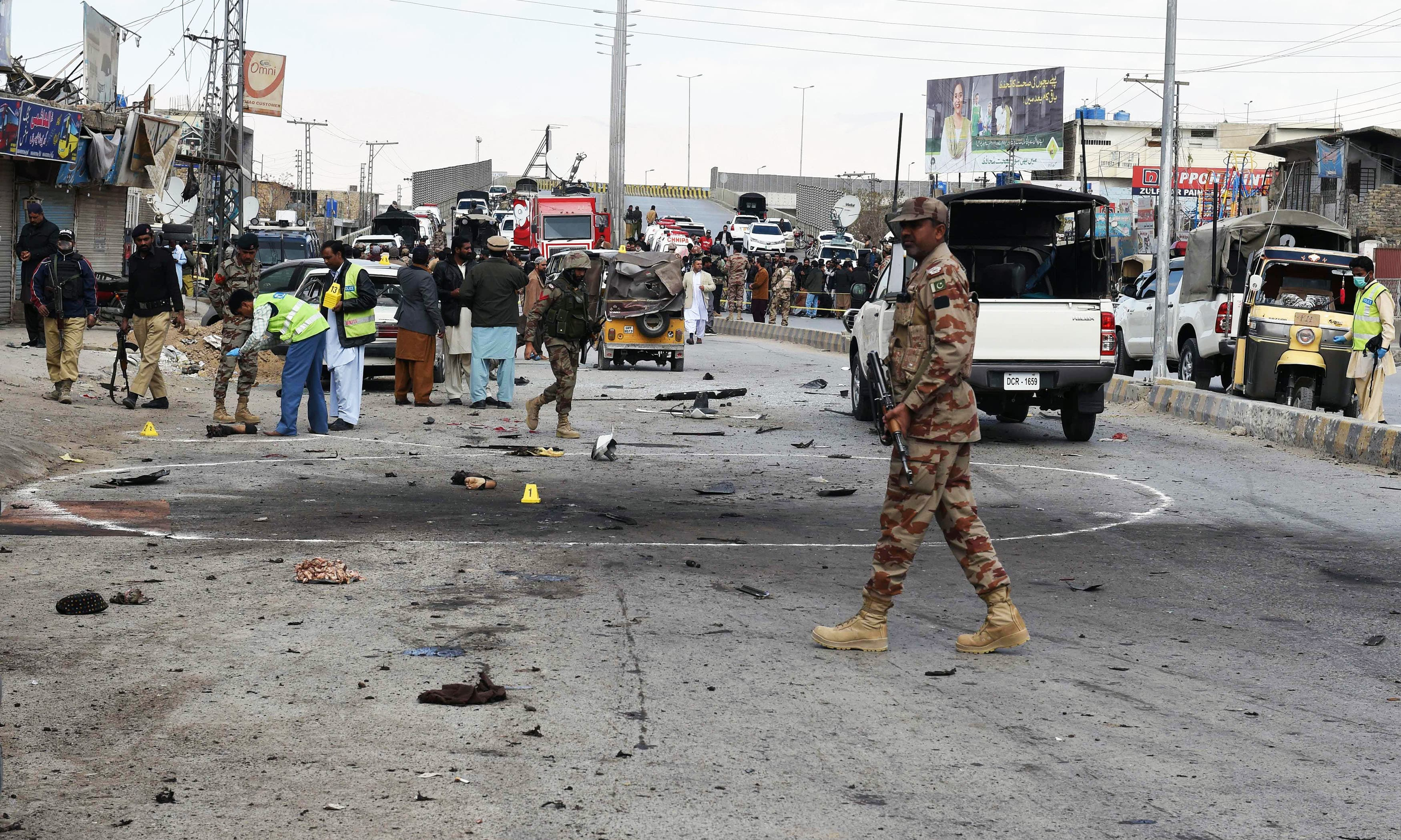 Security officials inspect the site of a suicide bombing in Quetta. —AFP