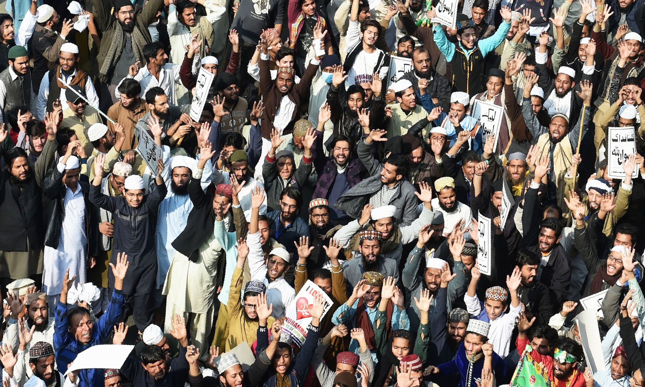 Religious activists shout slogans against the govt during a protest in Lahore. —AFP