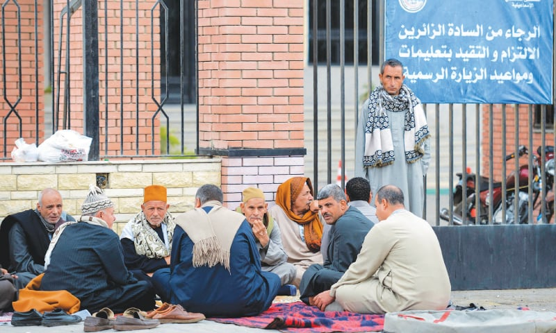 ISMAILIA: Relatives of the victims wait outside the Suez Canal University Hospital on Saturday.—AFP