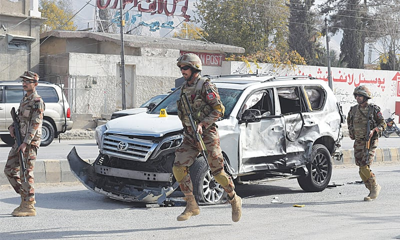 SOLDIERS arrive at the site of the suicide bombing in Quetta on Saturday.—AFP