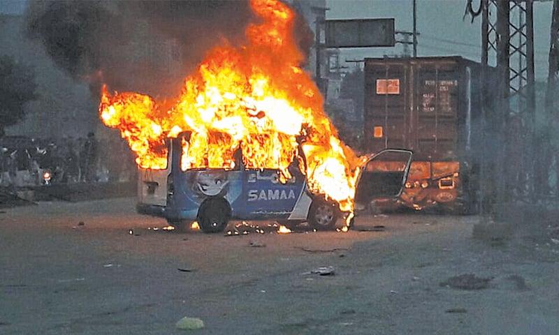 A DIGITAL Satellite News Gathering van of Samaa TV after enraged protesters set it ablaze.