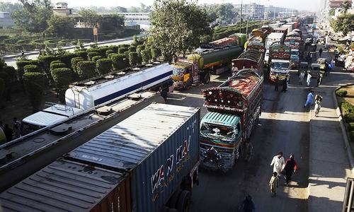 Trucks stuck in a traffic jam at a highway closed due to a rally by the supporters of religious groups, in Karachi.—AP