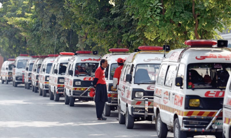Edhi ambulances parked along a road in I-8. — Photo by Tanveer Shahzad