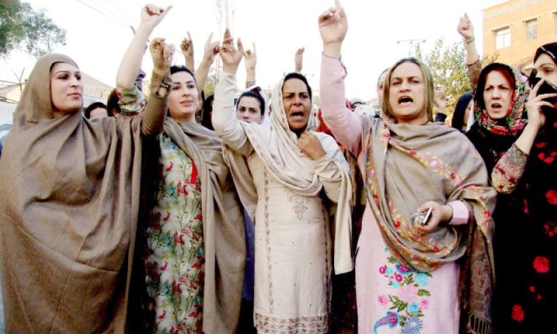 Transgender persons chant slogans during a protest in Peshawar on Sunday against the murder. — White Star