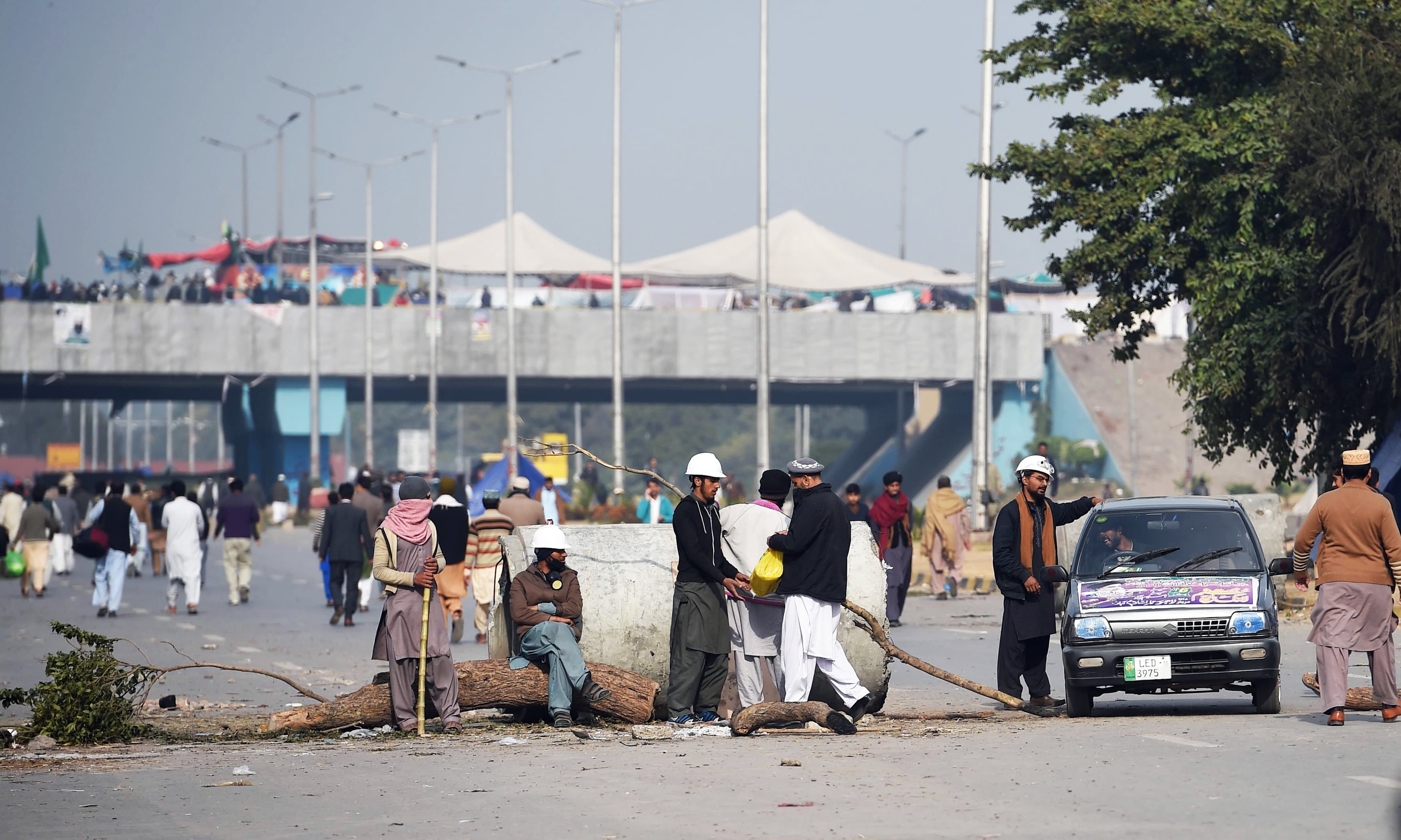 Protesters block a road in Islamabad. —AFP