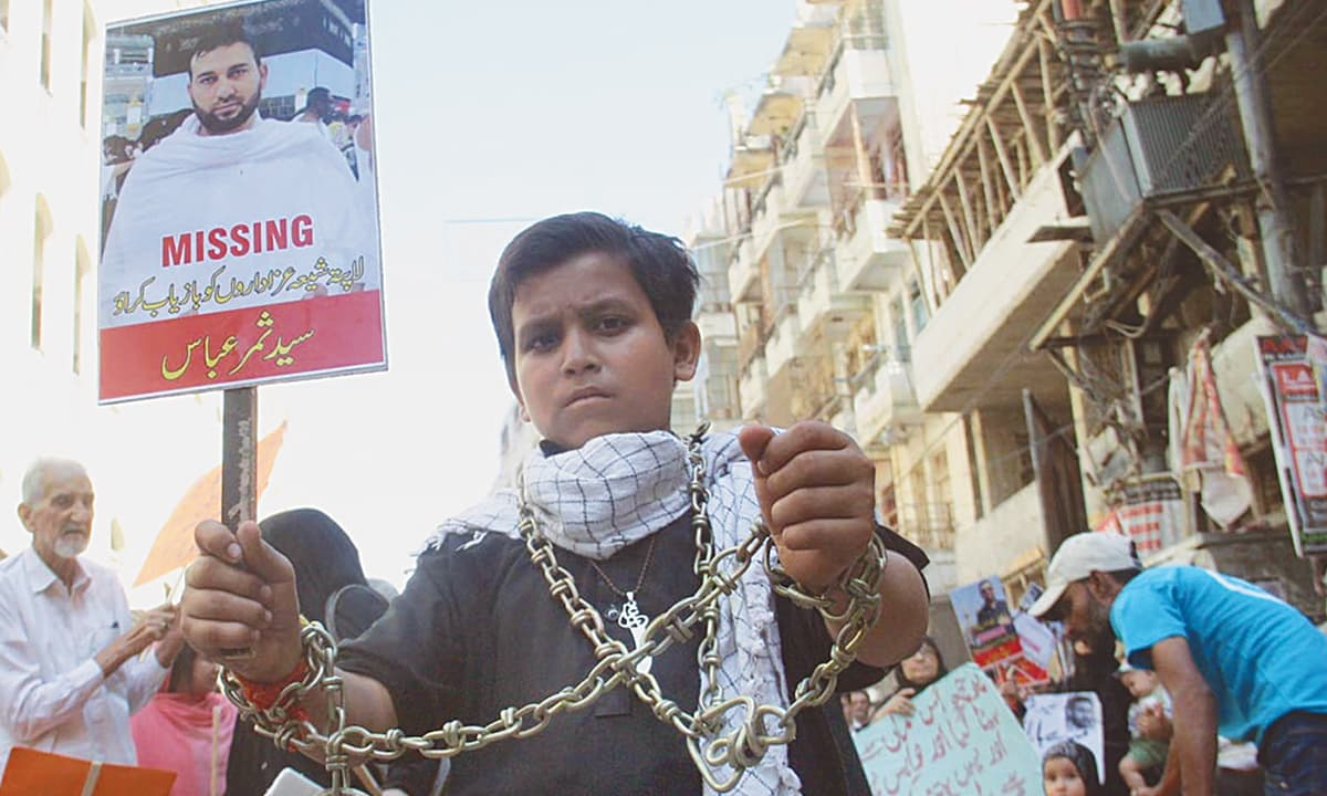 A child holds a placard in Karachi as part of a protest this October calling for the recovery of missing persons | Online