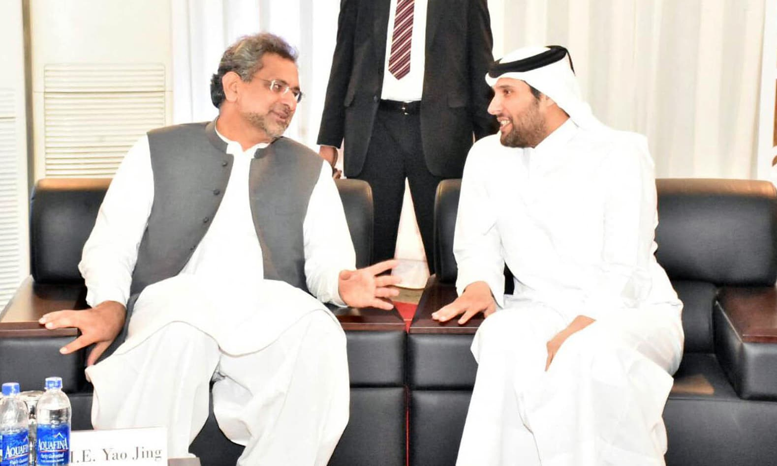 PM Abbasi and Sheikh Jassim exchange views following the inauguration of Port Qasim Coal-fired Power Plant. —Online