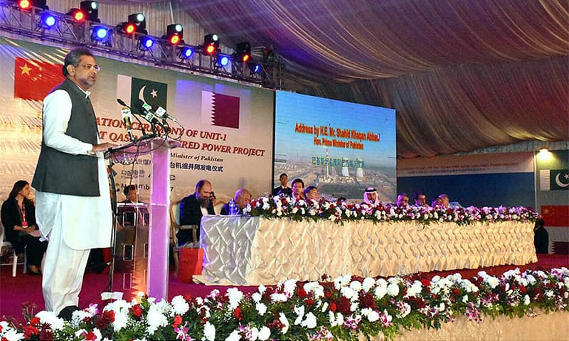 Prime Minister Shahid Khaqan Abbasi addresses the gathering on the occasion of inauguration of Unit-1 (660MW) of 1,320MW Port Qasim coal-fired power plant.— APP
