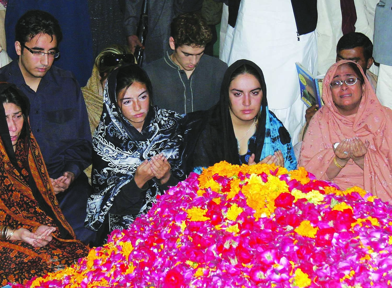 The assassination of Benazir Bhutto in Rawalpindi towards the end of 2007 led to a wave of sympathy for the party she used to lead – the Pakistan People's Party – and, subsequently, to Musharraf's ouster from the presidency. Bilawal Zardari (second from left), seen here grieving alongside sisters Asefa (centre) and Bakhtawar (second from right) at the gravesite of their mother in Garhi Khuda Bux, subsequently had to begin a life in politics, under the wings of father Asif Zardari, to take the Bhutto mantle forward. | Photo by Shakil Adil