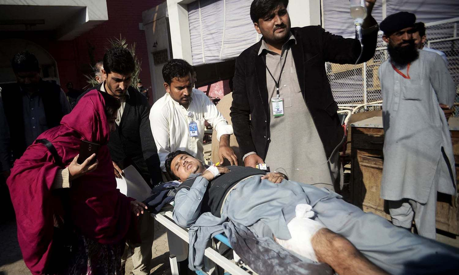 Staff rush a man to a hospital after he was injured during a crackdown operation against the terrorists. ─ AP