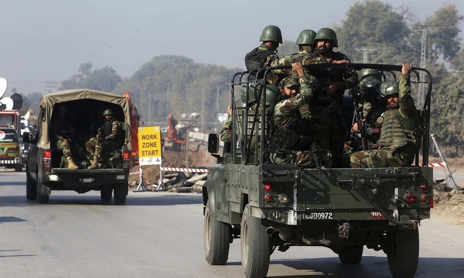 Army troops rush to the ATI which was stormed by terrorists in Peshawar. ─ AP