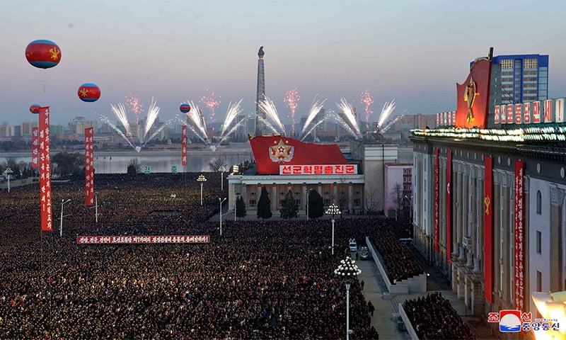 This December 1, 2017 picture released by North Korea's official Korean Central News Agency (KCNA) on December 2, 2017 shows North Korean soldiers and Pyongyang residents holding a rally to celebrate the North's declaration on November 29 it had achieved full nuclear statehood. ─ AFP