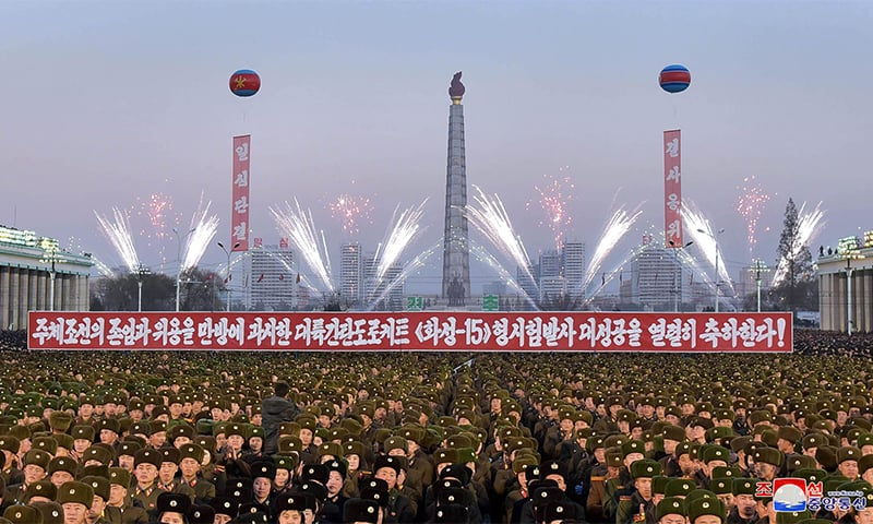 North Korean soldiers and Pyongyang residents holding a rally to celebrate the North's declaration on November 29 it had achieved full nuclear statehood. ─ AFP