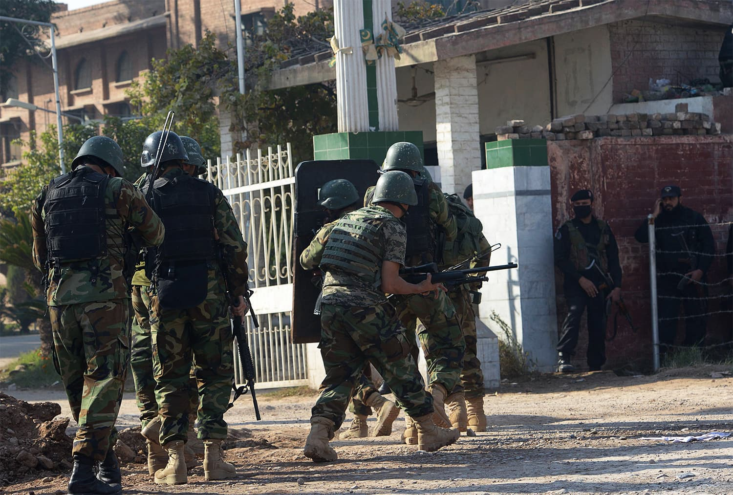 Army troops enter the ATI after the attack. ─ AFP