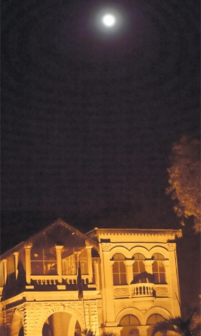 THE supermoon is pictured above the Flagstaff House on Saturday night. —Fahim Siddiqi / White Star
