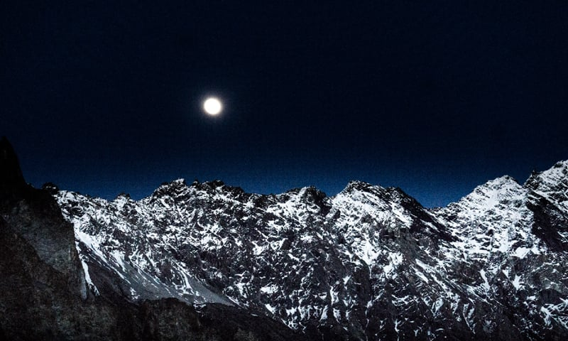 A view of the mountains on a full moon night in Passu