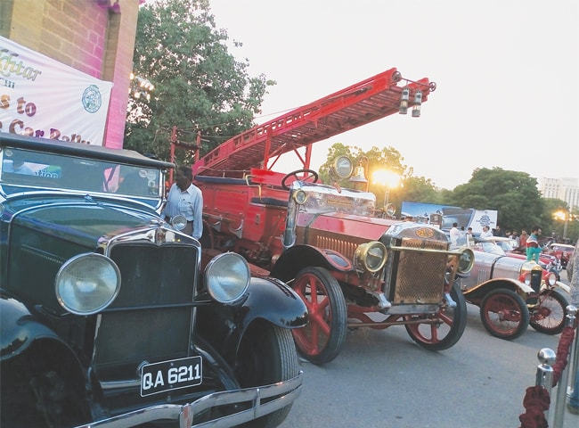 A 1912 fire tender, allowed to be displayed for the first time by  Karachi Mayor Waseem Akhtar, stands among other vintage and classic cars at the Karachi Car-Nival 2017 at Frere Hall on Sunday.—Photo by writer