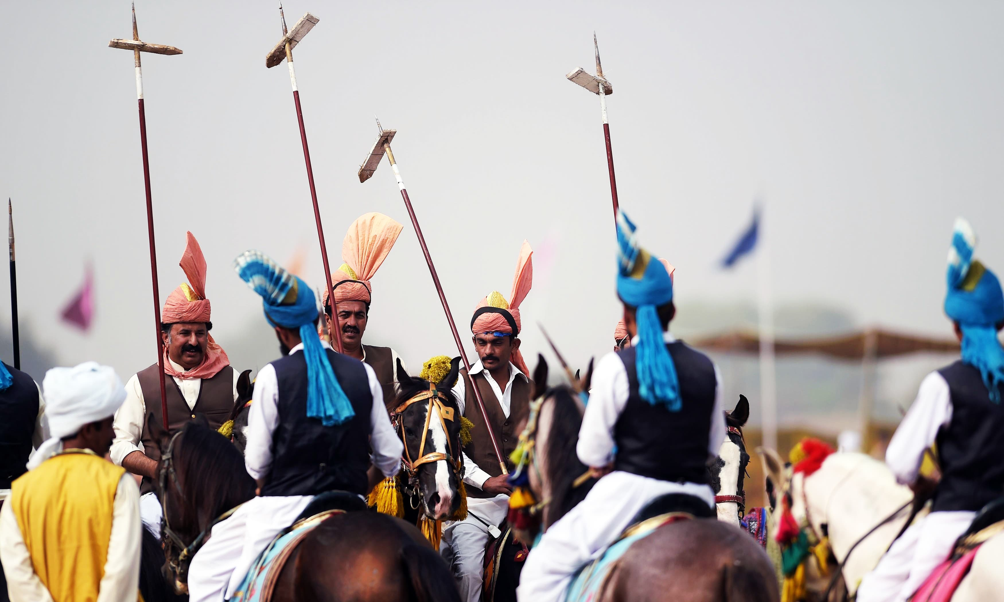 Festooned with garlands and colourful bridles, turbaned riders mounted on horseback in full gallop lower their lances at tiny wooden blocks as they practice the centuries-old tradition of tent-pegging. —AFP