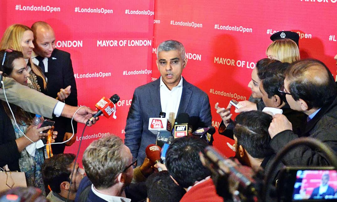 Sadiq Khan talks to media after a function at Al-Hamra. —APP