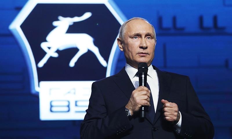 Russian President Vladimir Putin addresses workers of the GAZ factory in Nizhny Novgorod.—AFP