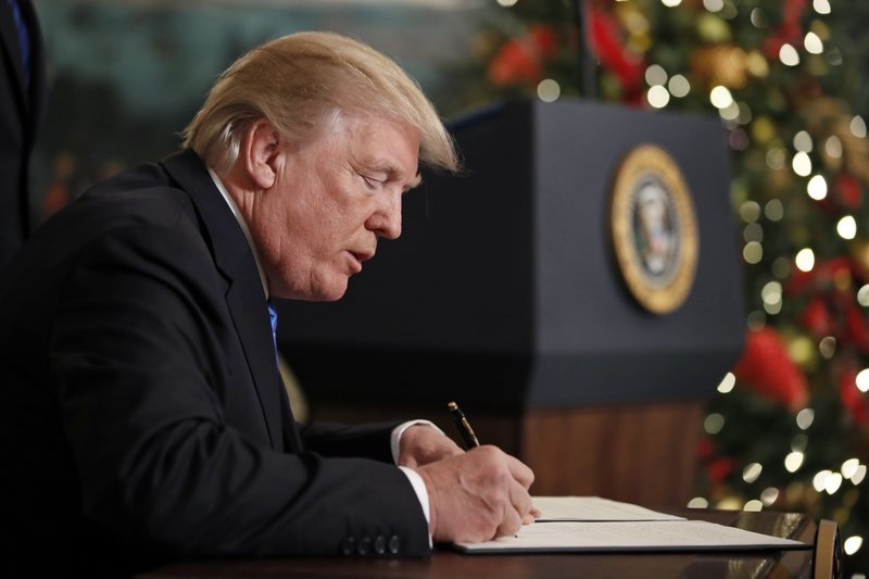 President Donald Trump signs a proclamation in the Diplomatic Reception Room of the White House on Wednesday, recognising Jerusalem as Israel's capital despite intense Arab, Muslim and European opposition to a move that would upend decades of US policy.—AP