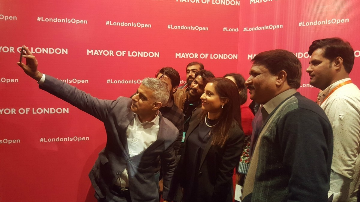 Sadiq Khan takes a selfie with admirers at his talk at Lahore's Alhamra yesterday — Photo by author