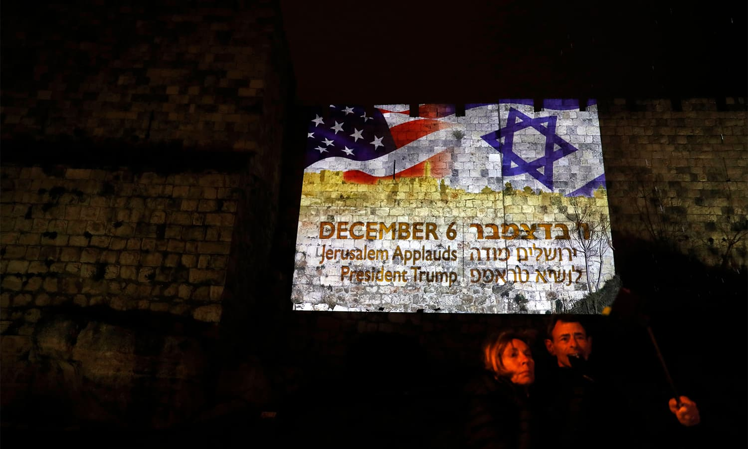 A giant US flag screened alongside Israel's national flag by the Jerusalem municipality on the walls of the old city.— AFP