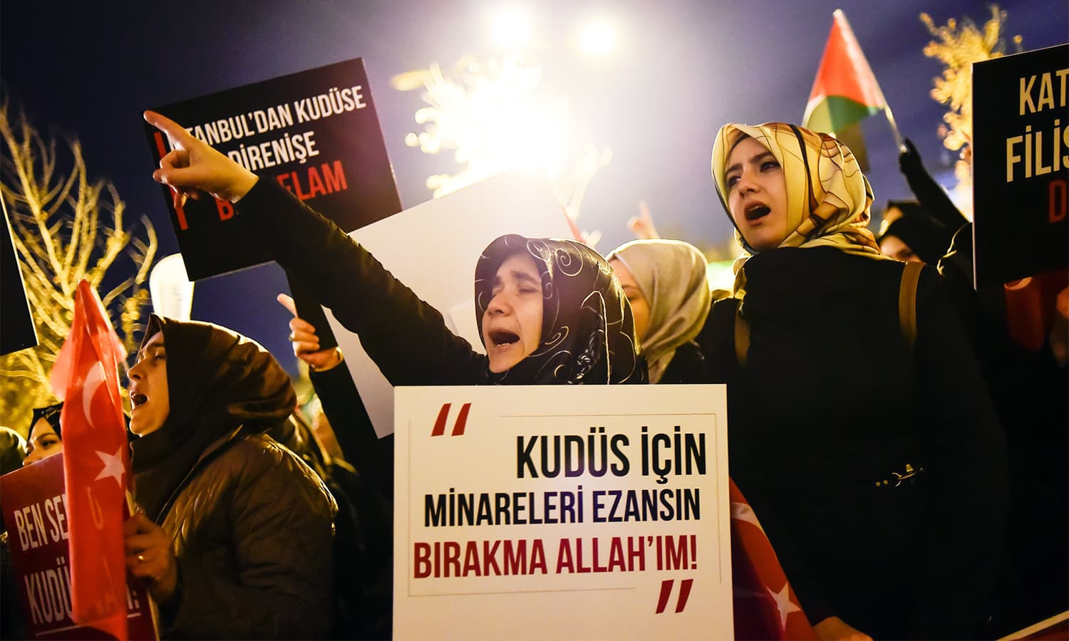 A woman holds a sign during a demonstration against the US and Israel at Fatih Mosque in Istanbul.— AFP