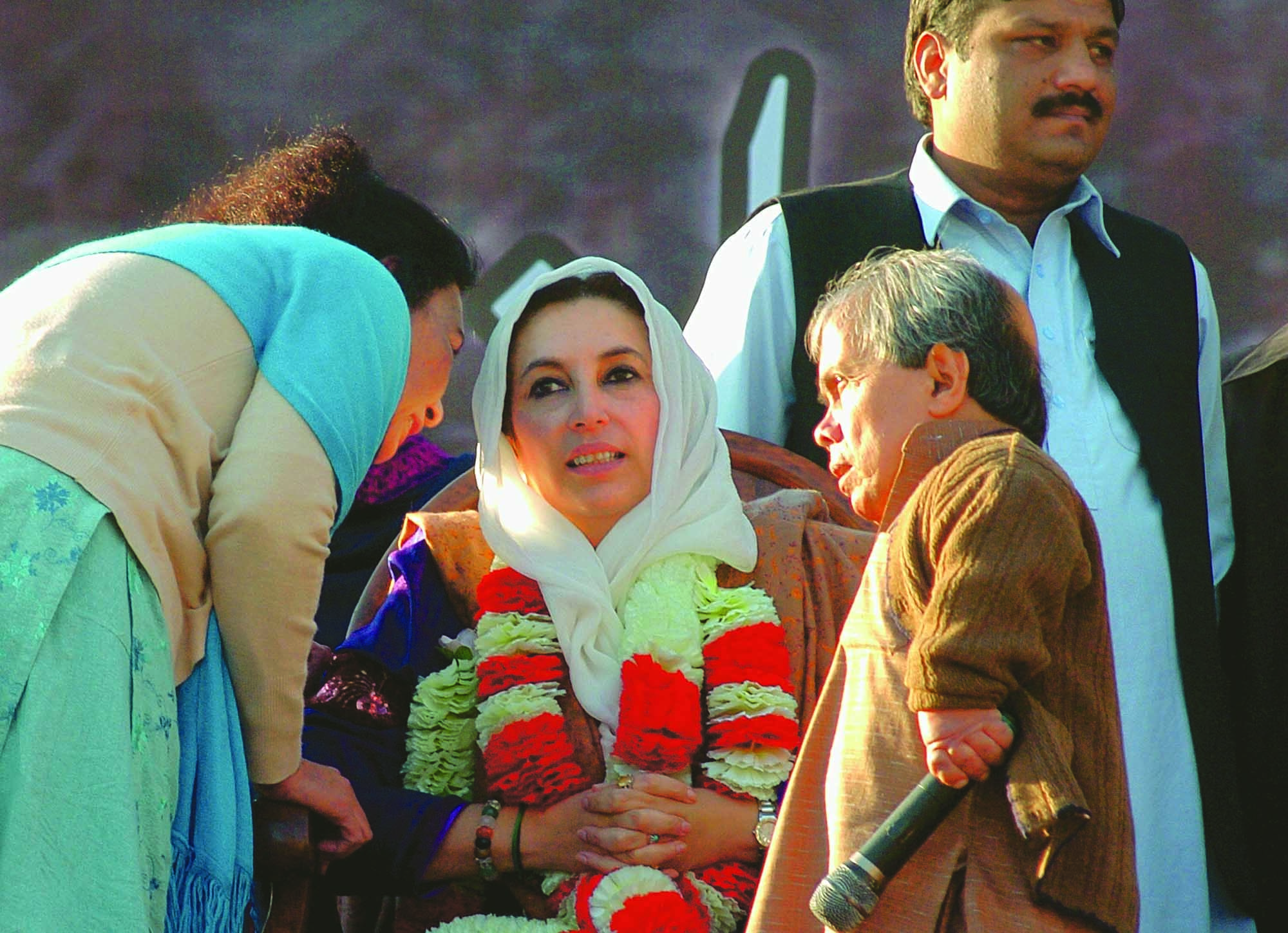 BENAZIR Bhutto receiving some last-minute brief from her close aide Naheed Khan as local party leader Sultan Qazi looked on. It was moments before Benazir Bhutto addressed a rally at the Liaquat Bagh in Rawalpindi on that fateful day of December 27, 2007, at the end of which she was no more and her husband Asif Ali Zardari became the new uniting force behind the Pakistan People's Party (PPP).