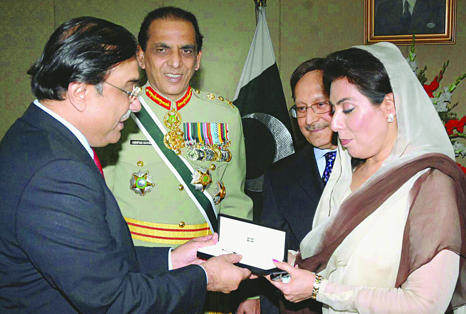 ONCE in office, Asif Zardari surprised many with his calm politics. He is seen here receiving a pen from National Assembly speaker Fehmida Mirza and Senate chairman Farooq H. Naek before signing on the dotted line to ratify a constitutional amendment. Army chief Ashfaq Parvez Kayani was also present on the occasion in a symbolic gesture of acknowledging parliamentary supremacy.