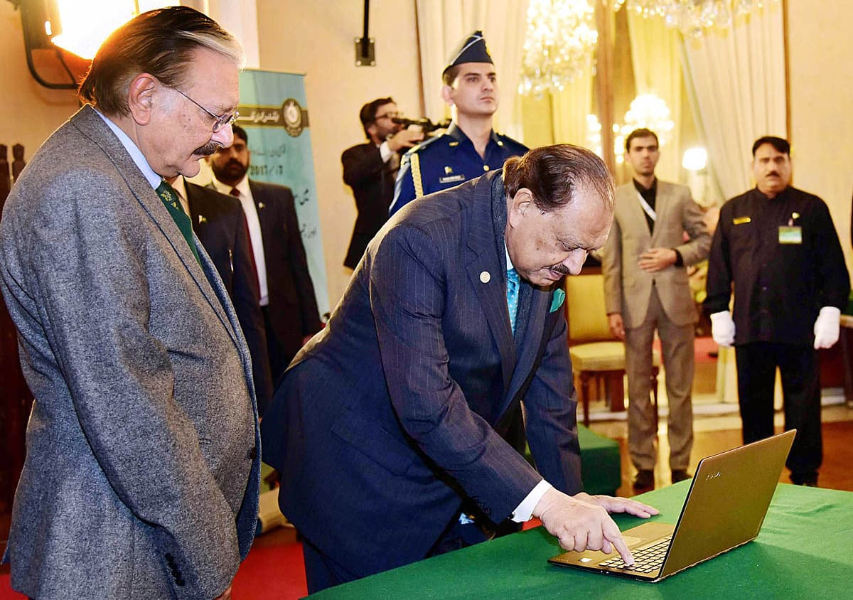 "President Mamnoon Hussain launches the application ""Click ECP"" during the ceremony of National Voters' Day. —APP"